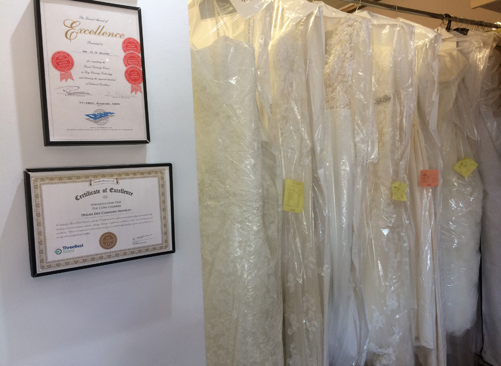 Cleaned and rejuvenated wedding dresses waiting to be collected